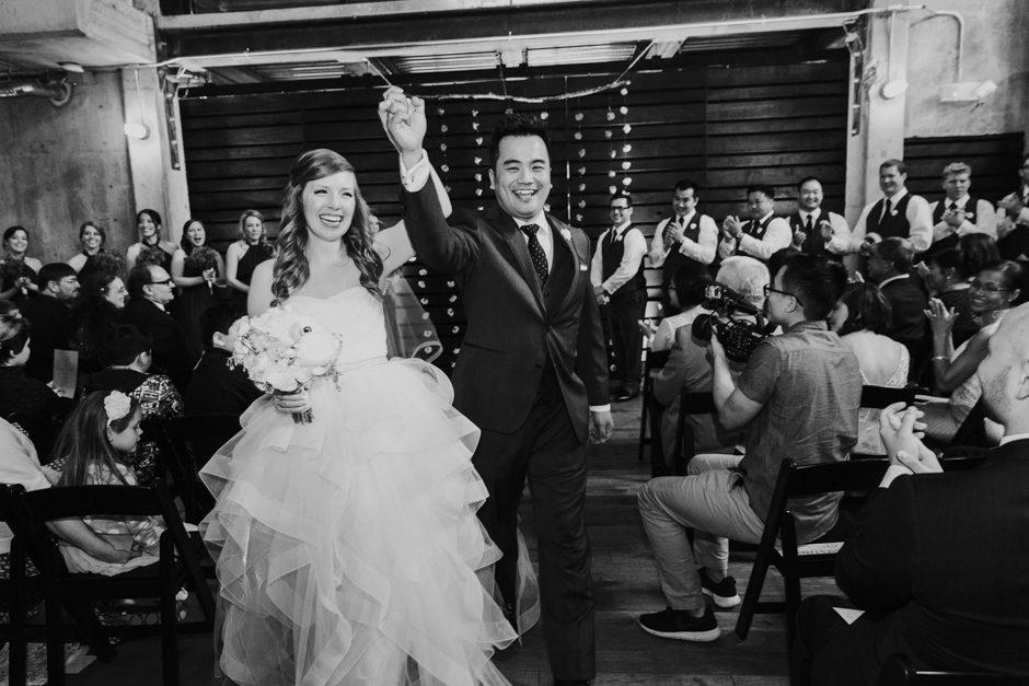 Couple toasts at Fremont Foundry wedding reception