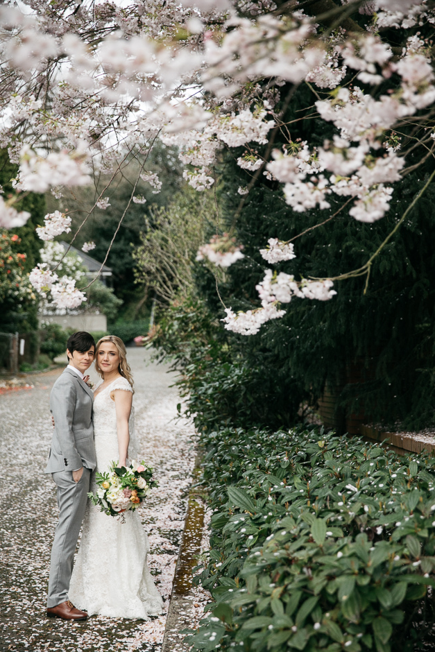 Couple stand on pathwway at Sodo Park Wedding