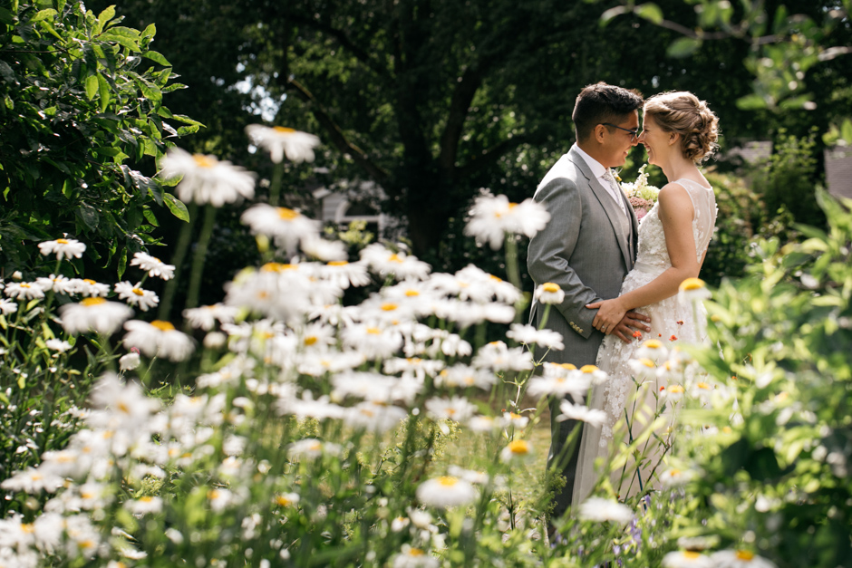 bride and groom in daisies