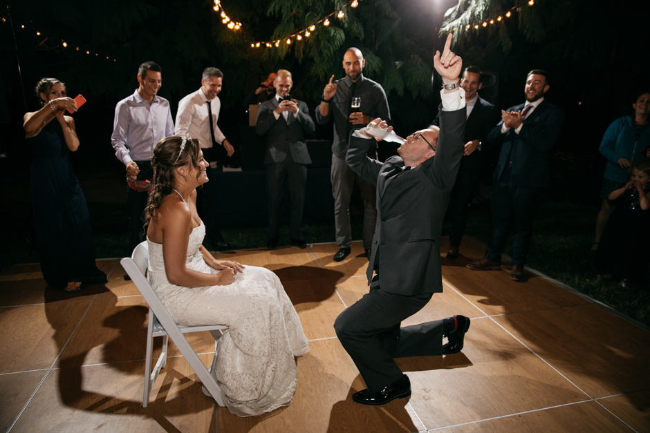 iced garter toss with bride and groom