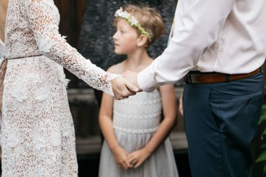 flower girl with bride and groom