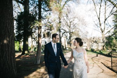 bride and groom walking in a park in seattle