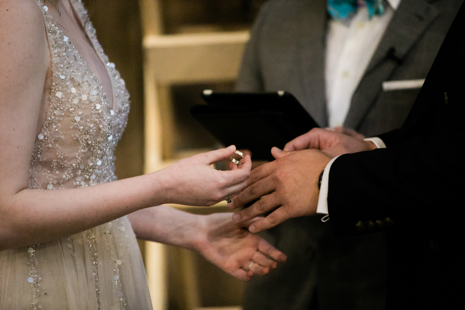 closeup of groom's ring during exchange