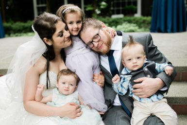 bride and groom with their children
