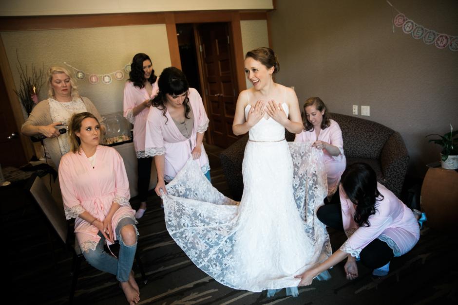 Bridesmaids helping brides at Willows Lodge wedding