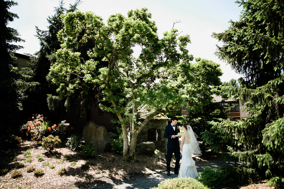 Bride and groom first look at Willows Lodge wedding