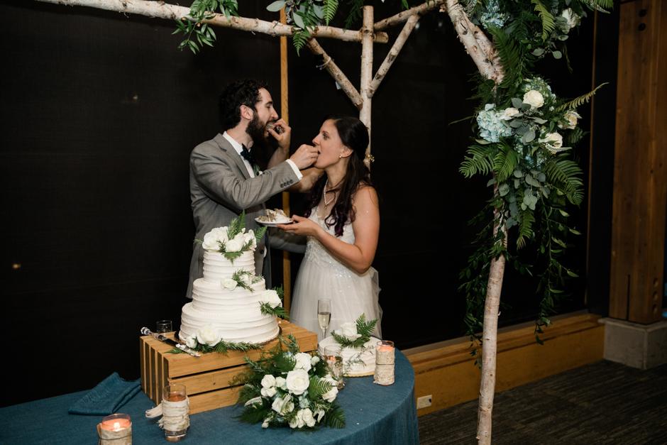 Cake eating at Cedarbrook Lodge wedding