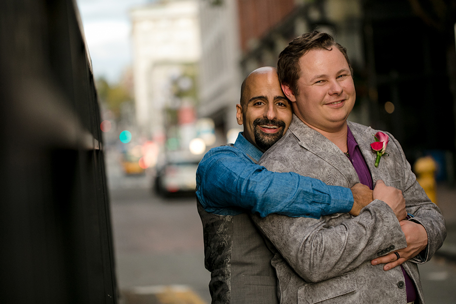 two grooms after their ceremony at axis pioneer square