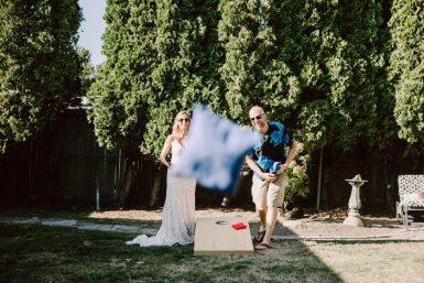 cornhole game during backyard wedding