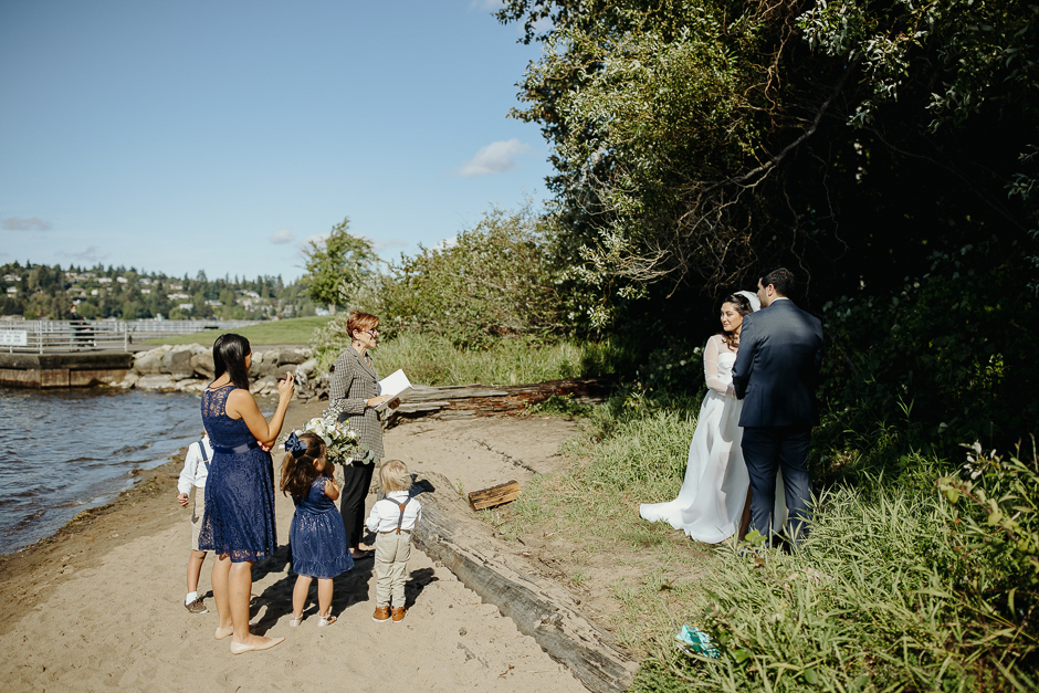 family with officiant on beach wedding ceremony on lake washington