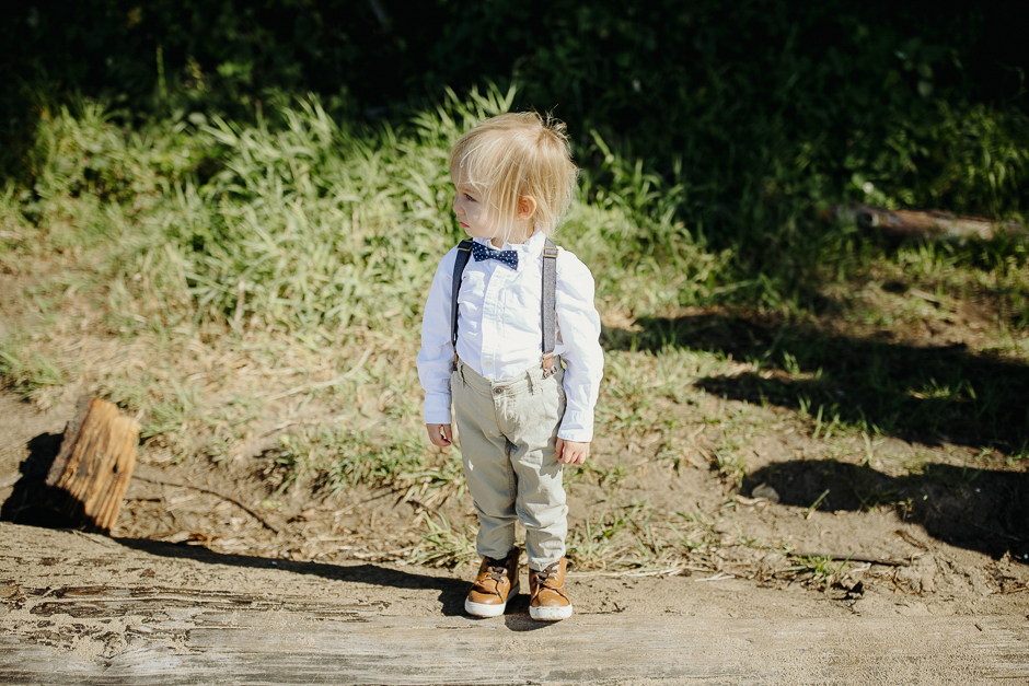 toddler on beach wedding in bow tie and suspenders