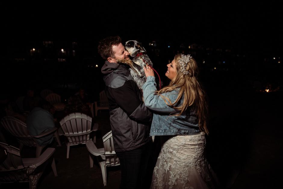Couple with their dog at Cannon Beach wedding reception