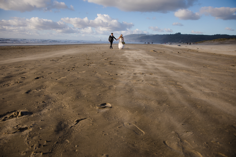cannon beach wedding couple walking on the beach