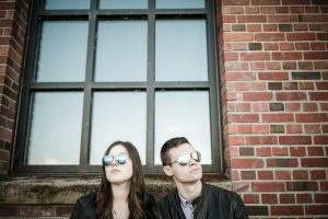 engaged couple in aviator glasses
