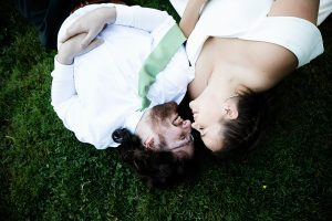 jardin del sol bride and groom laying on the grass