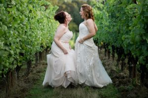 utopia vineyard same sex wedding two brides in the grape vines