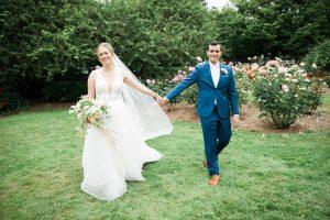 woodland park rose garden wedding bride and groom walking in garden