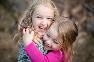 sisters hugging at discovery park
