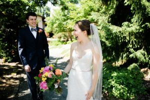 bride and groom walking on the grounds of willows lodge in woodinville on their wedding day